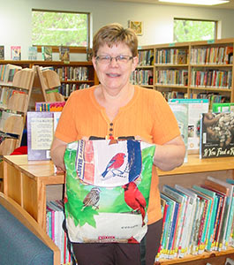 Dorchester Library director Sue Bedroske with Birding Backpack