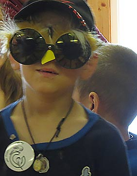 Young person wearing bird glasses