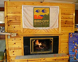Bird City banner over fireplace at IMBD event